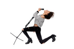 Beautiful young emotional heavy metal singer with microphone singing. Isolated on white Royalty Free Stock Photography