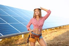 Beautiful young engineer on solar panels installation Stock Images