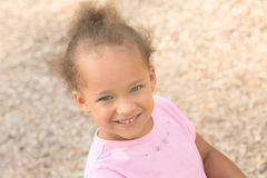 Beautiful Young Ethnic Girl. Wearing a pink shirt Stock Photography