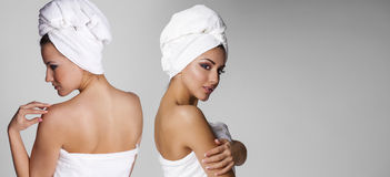 Beautiful young ethnic woman in white towel Stock Images