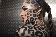 Beautiful young european model in cat make-up and bodyart Stock Photography