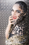 Beautiful young european model in cat make-up and bodyart Stock Photo