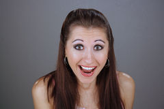 Beautiful Young Excited Brunette. Close-up of a lovely young brunette with an excited or surprised facial expression Stock Photo