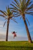 Beautiful young exciting woman in bikini jump Royalty Free Stock Image