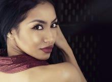 Beautiful young exotic woman wearing dress Royalty Free Stock Image