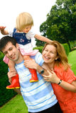 Beautiful young family Stock Images