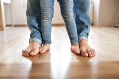 Beautiful young family. Bare feet of father and daughter. Stock Image