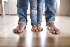 Beautiful young family. Bare feet of father and daughter. Beautiful young family. Close up of bare feet of father and daughter Stock Images