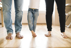 Beautiful young family. Bare feet of mother, father and daughter Royalty Free Stock Image
