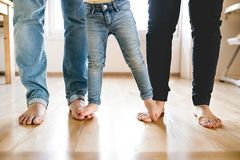 Beautiful young family. Bare feet of mother, father and daughter Royalty Free Stock Images