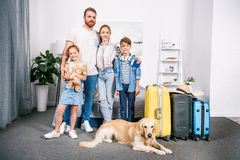 beautiful young family with dog in bedroom ready Stock Photography