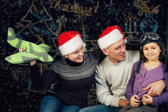 A beautiful young family dreams of a Christmas trip Royalty Free Stock Photos
