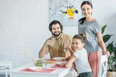 beautiful young family eating stock photos