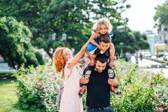Beautiful young family with ice cream. Walking on the street royalty free stock images