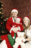 Beautiful young family with little cute baby girl on Christmas. Beautiful young couple that made a wonderful family and have cute baby girl. beautiful wife and royalty free stock photos