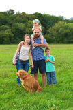 Beautiful young family with their pet dog Stock Photography