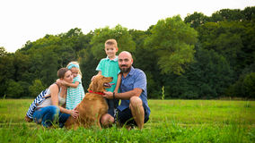 Beautiful young family with their pet dog Royalty Free Stock Photos
