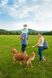 Beautiful young family with their pet dog Stock Image