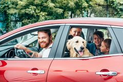 Beautiful young family travelling by car. With dog royalty free stock photos