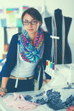 Beautiful young fashion designer standing in studio Royalty Free Stock Photography