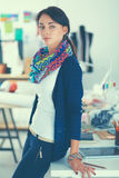Beautiful young fashion designer standing in studio Royalty Free Stock Photos
