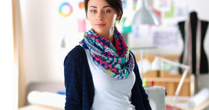 Beautiful young fashion designer standing in studio Royalty Free Stock Image
