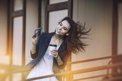 Beautiful young fashion gir with take-away coffee in hand Stock Image