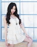 Beautiful young fashion model. Beautiful young Asian fashion model posing outside Stock Image