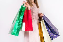 Woman with shopping bags in hands and lace cream color dress stock photography