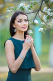 Beautiful young fashion model with with long hair wearing jewelr Stock Photography