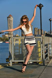 Beautiful young fashion model posing pretty on the pier Royalty Free Stock Photos
