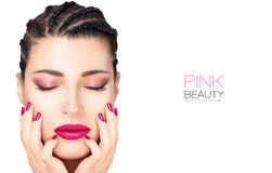 Beautiful fashion girl with braided hair, pink lipstick, nails and eye shadow. Beauty makeup concept royalty free stock photography