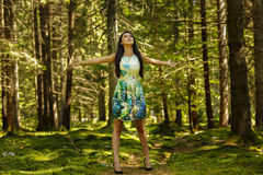 Beautiful young fashion woman in color dress posing outdoor in g Stock Image