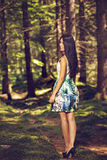 Beautiful young fashion woman in color dress posing outdoor in g Royalty Free Stock Image