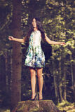 Beautiful young fashion woman in color dress posing outdoor in g Stock Photography