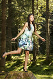 Beautiful young fashion woman in color dress posing outdoor in g Royalty Free Stock Photo