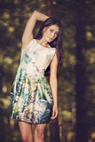 Beautiful young fashion woman in color dress posing outdoor in g Royalty Free Stock Images