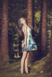 Beautiful young fashion woman in color dress posing outdoor in g Stock Images