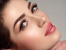 Beautiful young fashion woman with fashionable makeup royalty free stock photography