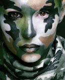 Beautiful young fashion woman with military style clothing and f Royalty Free Stock Photography
