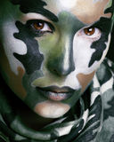Beautiful young fashion woman with military style clothing and f Royalty Free Stock Images