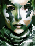 Beautiful young fashion woman with military style clothing and f Stock Photos