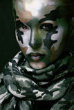 Beautiful young fashion woman with military style clothing and face paint make-up Stock Images