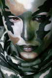 Beautiful young fashion woman with military style clothing and face paint make-up Royalty Free Stock Photography