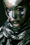 Beautiful young fashion woman with military style clothing and face paint make-up Royalty Free Stock Photo