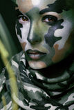 Beautiful young fashion woman with military style clothing and face paint make-up Royalty Free Stock Images