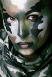 Beautiful young fashion woman with military style clothing and face paint make-up Stock Image