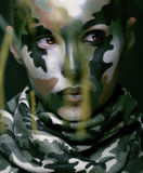 Beautiful young fashion woman with military style clothing and face paint make-up Royalty Free Stock Image