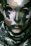 Beautiful young fashion woman with military style Stock Images