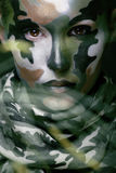 Beautiful young fashion woman with military style clothing and face paint make-up, khaki colors, halloween celebration stock photography